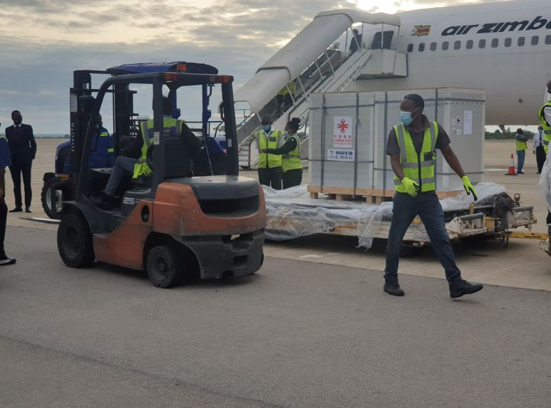 Workers at the Robert Gabriel Mugabe Airport in Harare coordinate the transfer of Sinopharm vaccines donated by the Chinese government to Zimbabwe. PHOTO: CGTN Africa/Farai Mwakutuya